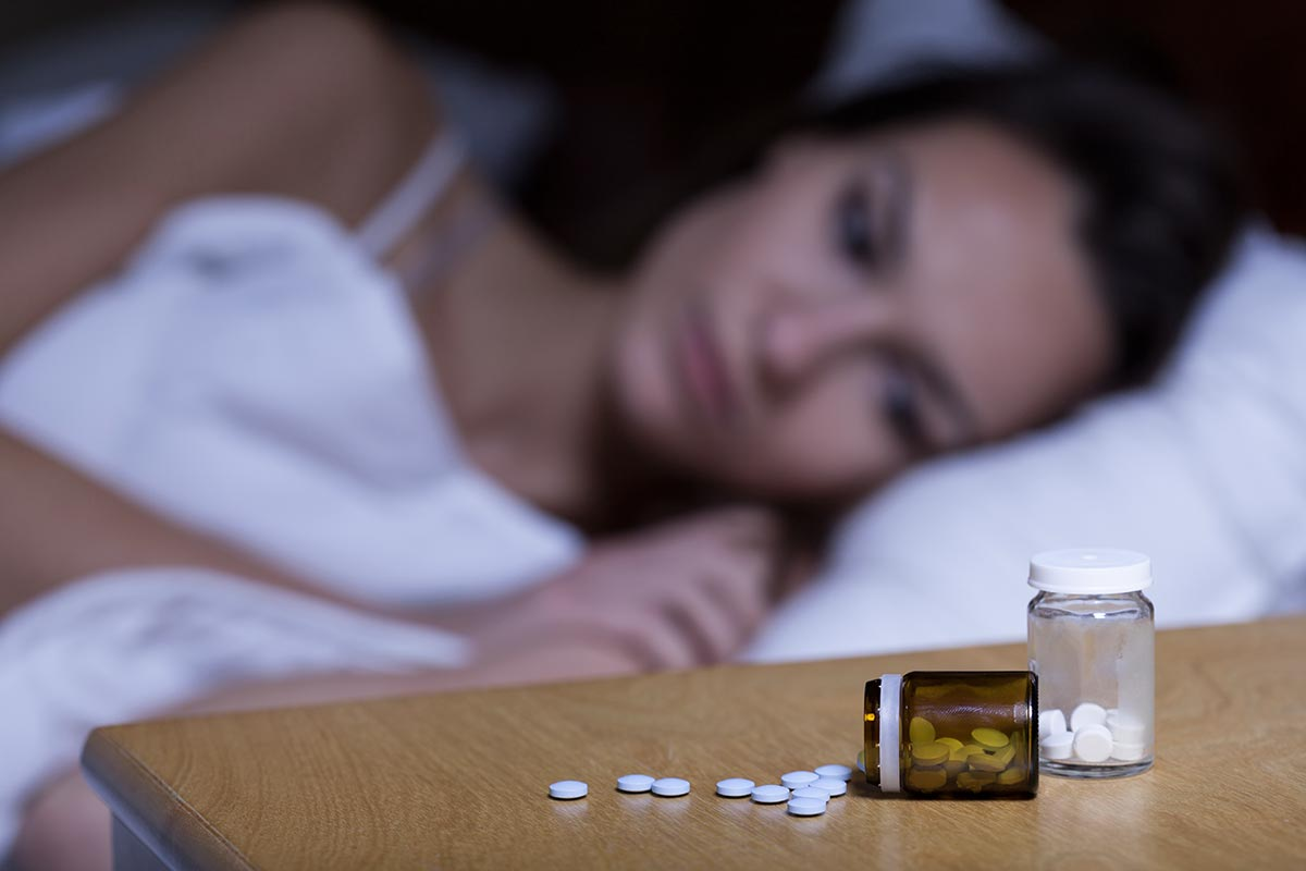 anaheimlighthouse-sleeping-pills-history-use-and-abuse-article-photo-woman-lying-in-bed-taking-sleep